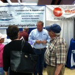 Dave Jones talks to clients at the booth.