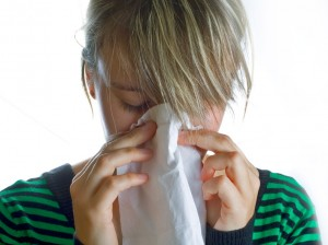 sick-woman-blowing-nose