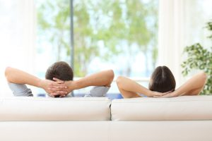 couple-satisfied-with-temperature-recline-on-white-couch