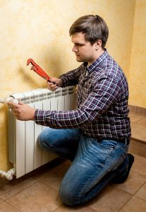 technician-working-on-radiator