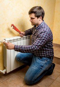 technician-working-on-radiator