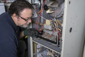 technician-giving-furnace-maintenance-tune-up