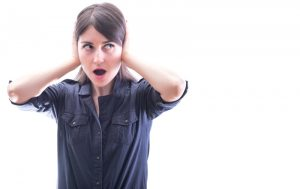 woman-covering-ears-from-loud-furnace-noises